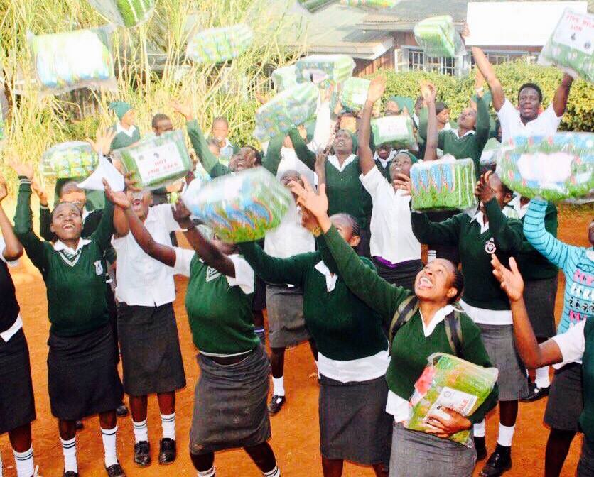 Distributing sanitary products to girls in the Kibera slums in Kenya through Girls Health Ed and the Mama Sarah Obama Foundation